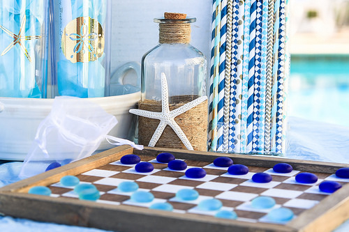 Cheap Coastal Decor. Add the coastal look by adding strong areas of white with a little floral print to contrast. #coastaldecor